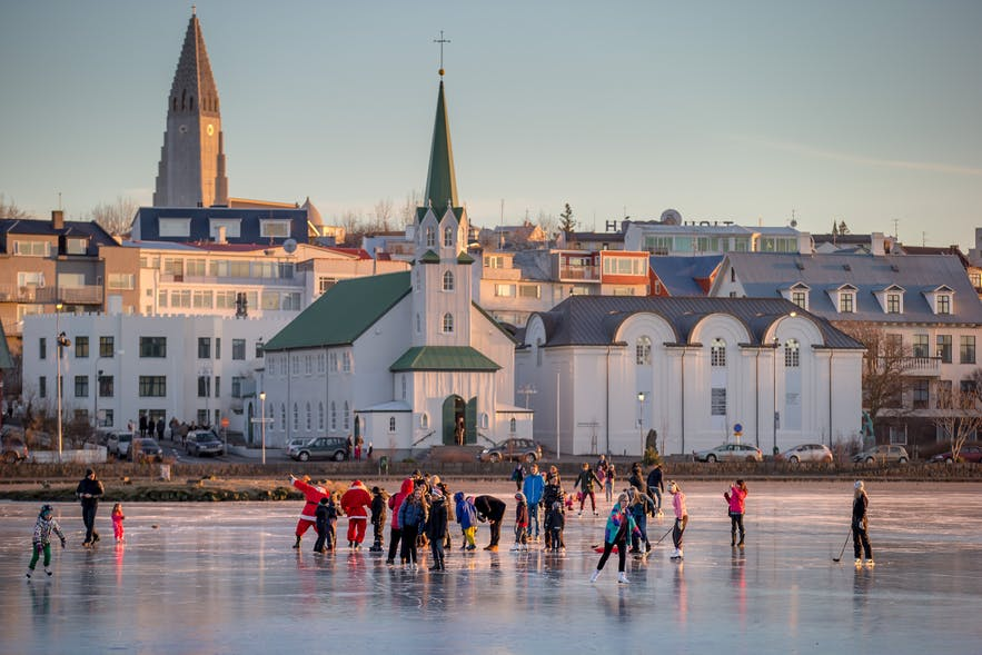 Christmas ice skating on Tjörnin in downtown Reykjavík