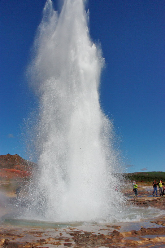 The geyser Strokkur spouting hot water high in the air
