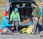 Guest preparation at Sólheimajökull glacier parking-lot.