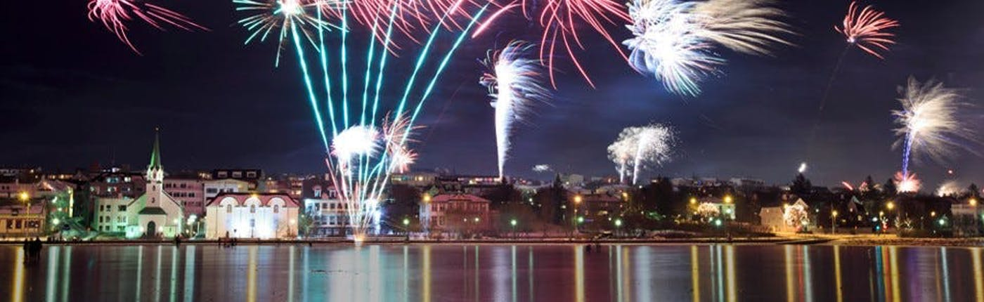 Views of Reykjavík's fireworks on New Year's Eve from Tjörnin