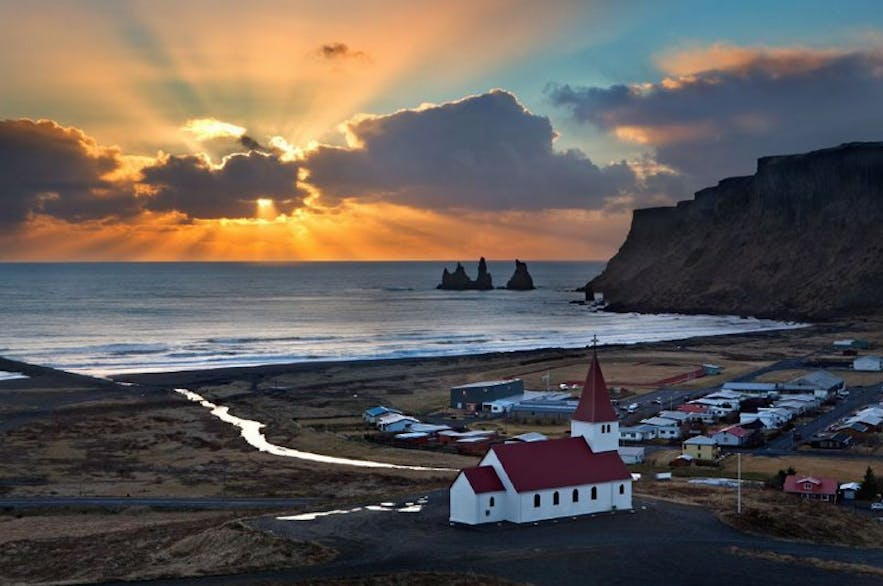 The town of Vik is known for its scenic beauty, and for the nearby black sand beach, Reynisfjara.