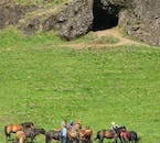 Icelandic horses in front of a cave where elves are said to live.