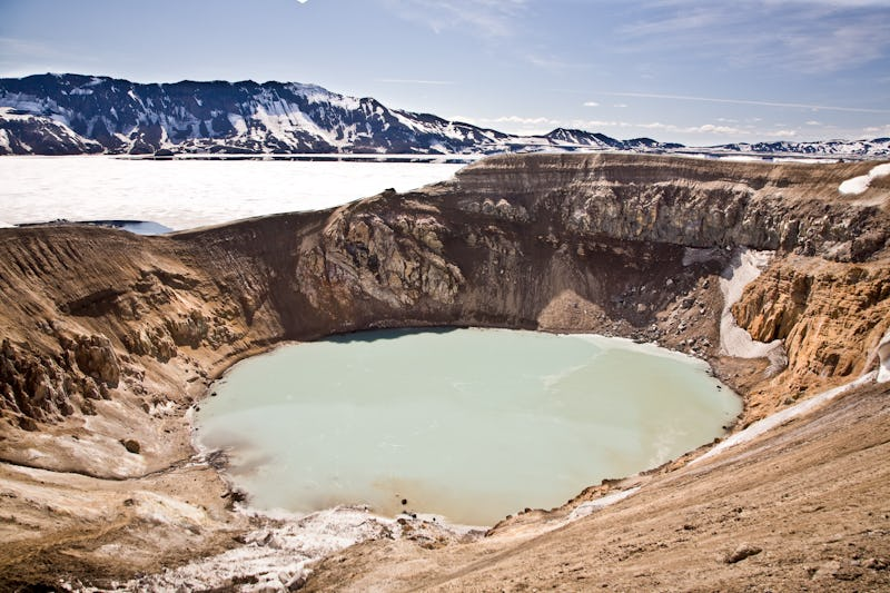 The Askja Caldera boasts a milky-coloured crater lake, that stunningly contrasts the red hills of the volcano.