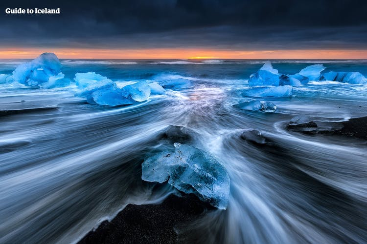 The Diamond Beach is a site of contrasts in South Iceland, where the black sands, blue ice and white surf form a stunning composition.
