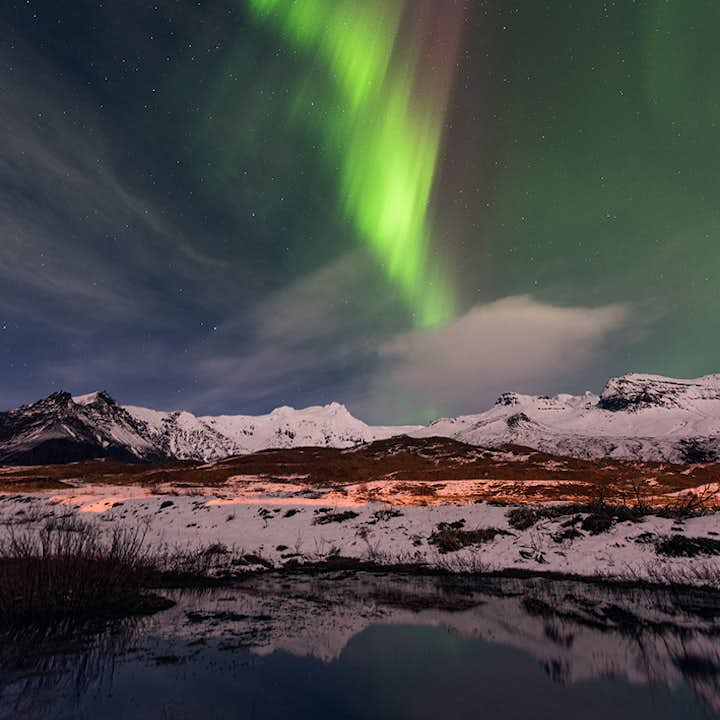 The northern lights descending from a starry sky.