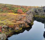 A rift in Þingvellir park, filled with crystal clear spring water.