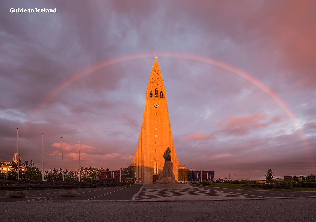 Hallgrímskirkja church, under the rainbow in Reykjavík city