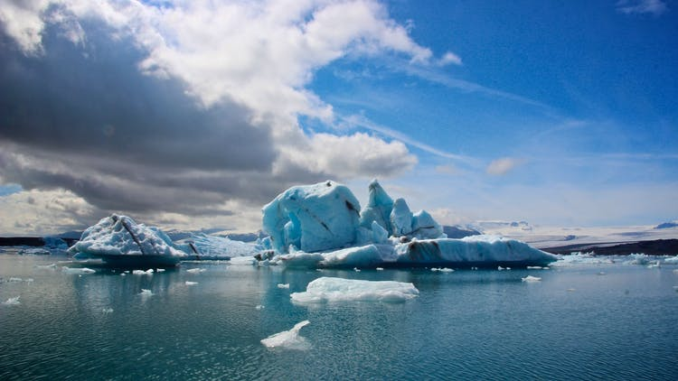 Icebergs float on the serene waters of Jökulsárlón glacier lagoon, before they drift off to sea