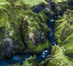 On a self-drive tour, you can stop at off-the-beaten-path locations like at the dramatic Fjaðrárgljúfur canyon.