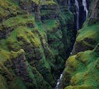 An aerial perspective over Glymur Waterfall.