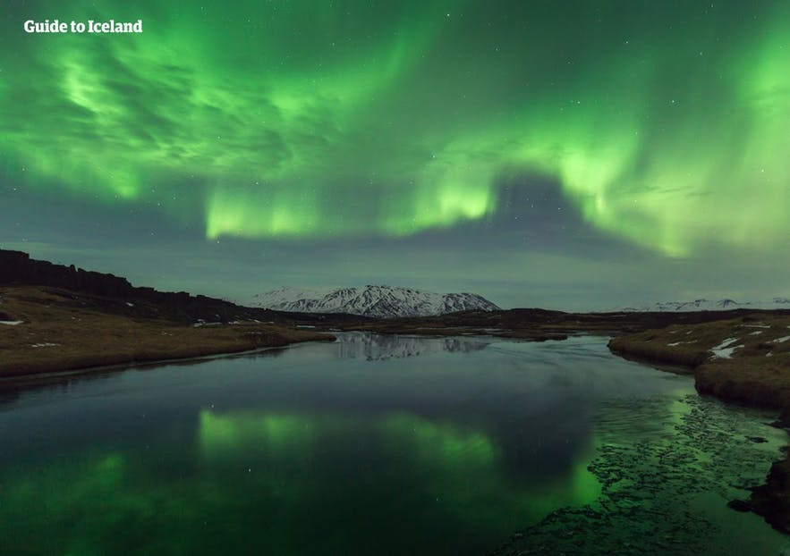 Beautiful Northern Lights reflected in water in Iceland