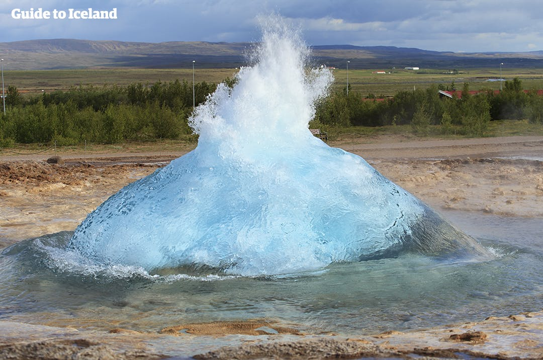 See the mighty Strokkur erupt in the Geysir geothermal area.
