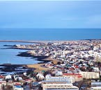 The edge of Iceland's capital Reykjavík sits right by the roaring Atlantic Ocean, looking out across Faxaflói Bay.
