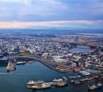 Obtain a sweeping and panoramic city view over Reykjavík on a private helicopter tour that sets out from the domestic airport.