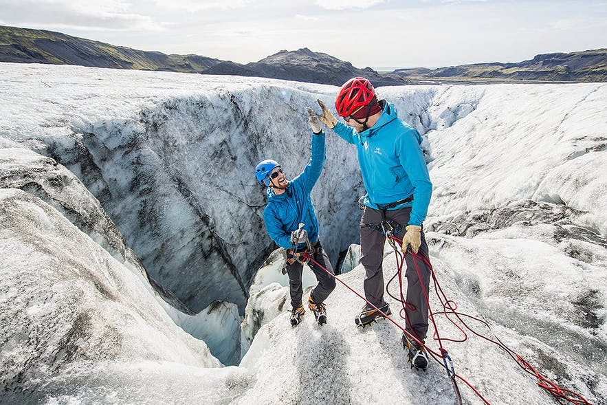 With hats under their helmets, gloves, wind- and waterproof outer layers and sturdy hiking shoes, these two ice climbers are excellent examples of how to dress to prepare for Iceland.