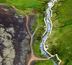 Reykjadalur the hot spring valley in Hveragerði looks spectacular from above when taking a helicopter tour in Iceland.