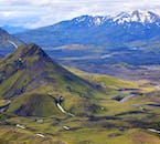 The stretches of mountains and rivers truly appear when flying over the Highlands of Iceland in a helicopter.