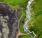 Flying over the hot spring valley Reykjadalur in Hveragerði and enjoying the geothermal views from a helicopter.