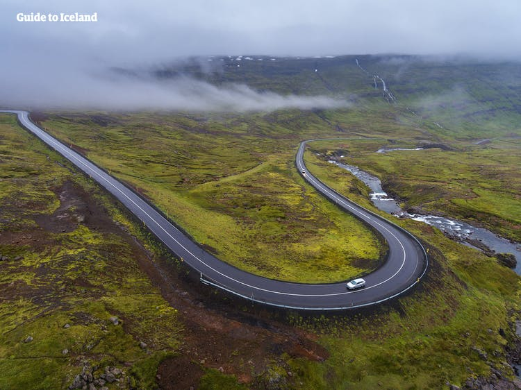 Driving the twisting mountain road of Seyðisfjörður in the East Fjords of Iceland.
