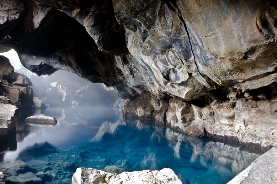 Grjótagjá is a cave with stunning blue water near lake Mývatn in north Iceland