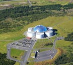 See landmark buildings such as Perlan on a helicopter tour over Reykjavík city.