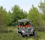 Travel through a wooden area on a buggy tour from Akureyri town.