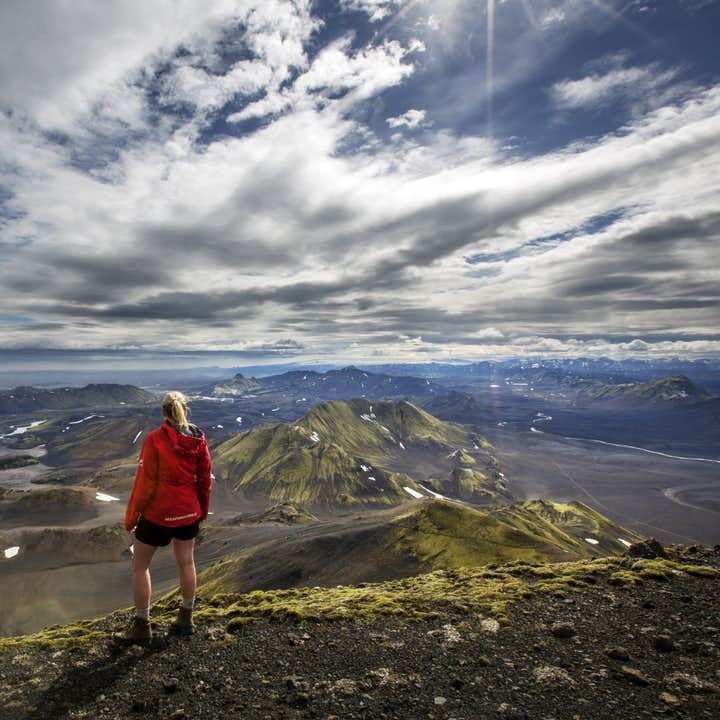 Standing on top of the mountain peak Sveinstindur in Iceland provides a stunning view of the Highlands.