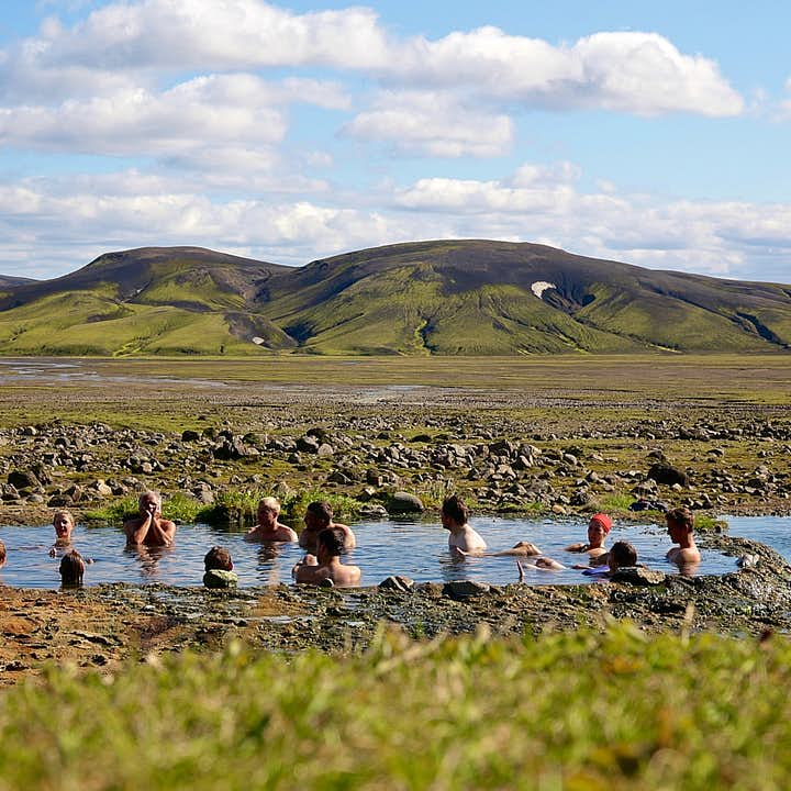 Hikers enjoying a much-deserved soak in the geothermal hot spring Strútslaug in the southern part of the Icelandic Highlands.