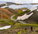 Even in summer, patches of snow still blanket the colourful hills of the central Icelandic Highlands.