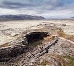 Opening of Víðgelmir Cave in the stretching lava fields of Hallmundarhraun in West Iceland.