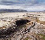 Opening of Víðgelmir Cave in the stretching lava fields of Hallmundarhraun in West Iceland.