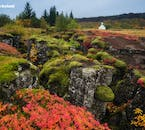 Þingvellir National Park in its autumn colours, with the church Þingvallakirkja nesting in the scenic lava fields of the continental rift valley.