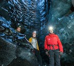 The blue and white ice inside the ice cave in Mýrdalsjökull has been blackened by ash from past volcanic eruptions