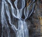 Hraunfossar waterfall can be found in the Borgarfjörður Region.