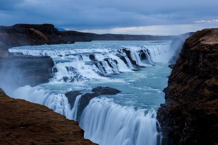 One part of the Golden Circle, the waterfall Gullfoss plummets 32 metres in two stages into a rugged canyon