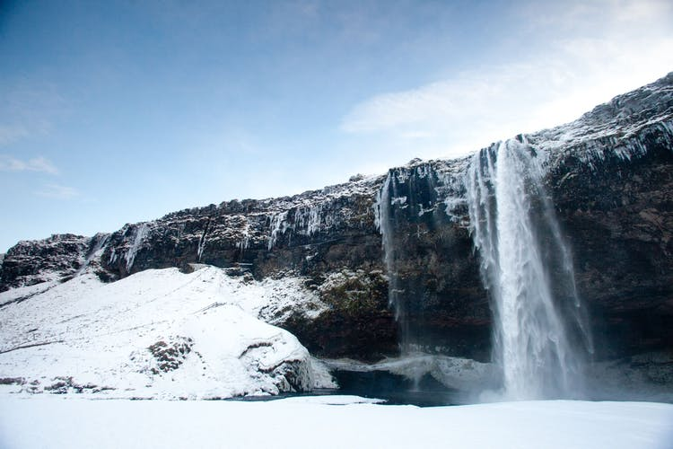 Iceland's South Coast is filled with natural wonders like black sand beaches and cascading waterfalls
