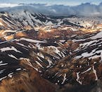 The mountains of the Landmannalaugar region in the Highlands of Iceland are colourful and striking as they stretch out across the Laugahraun lava field.