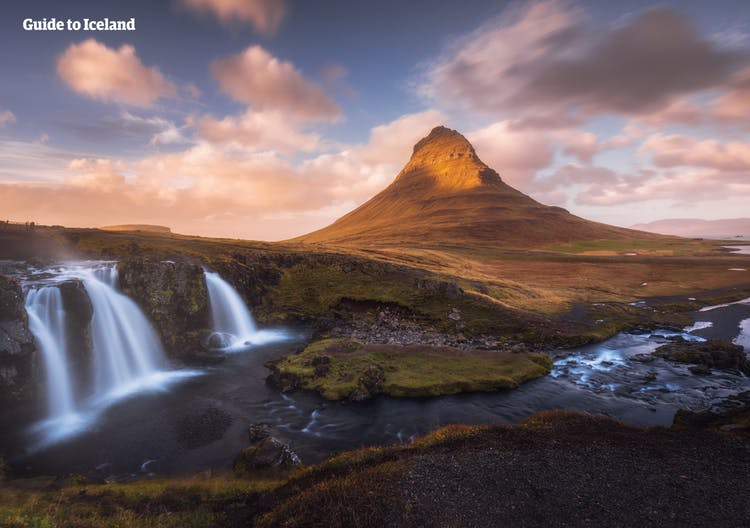The triple cascade of Kirkjufellsfoss constitutes a beautiful foreground for Mt. Kirkjufell, as its peak is painted gold by the midnight sun of Iceland.