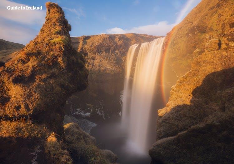 Skógafoss on the South Coast of Iceland, along with a colourful rainbow created by the sun hitting the mist of the South Coast marvel.