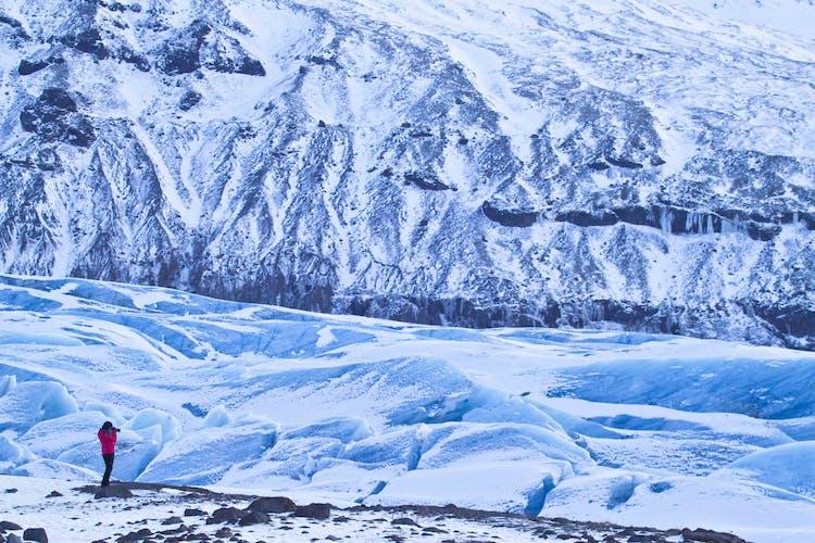 Go glacier hiking on Svinafellsjökull glacier and pass deep crevasses and blue ice sculptures.
