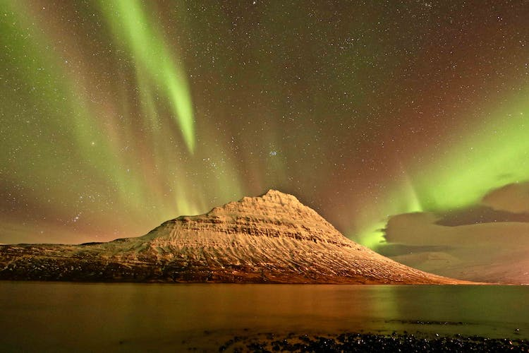 Watch the Northern Lights dance in the evening sky on your 10-day adventure tour.