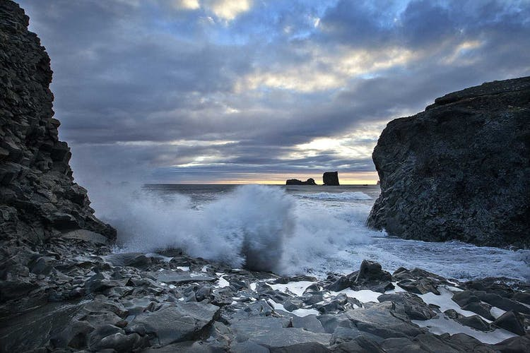 Take care of the powerful sneaker waves when you explore Reynisfjara black sand beach on the South Coast of Iceland.