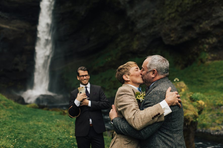 Beautiful wedding ceremony by one of Iceland's stunning waterfalls