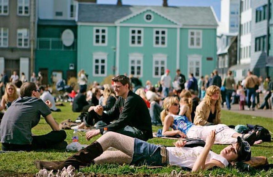 People drinking at Austurvöllur square in central Reykjavík