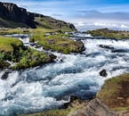 A crystal clear Highland river in Iceland filled with glacier water.