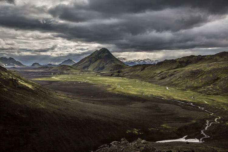 Pictured is the mountain Stórasúla in the southern Highlands of Iceland underneath a stormy sky.
