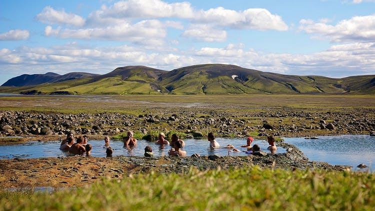 Bathing in the natural hot spring of Strútslaug in the Highlands of Iceland is a popular activity for passing hikers.