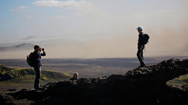 Taking a picture on a misty day by the outwash sand plain Mýrdalssandur in Iceland.
