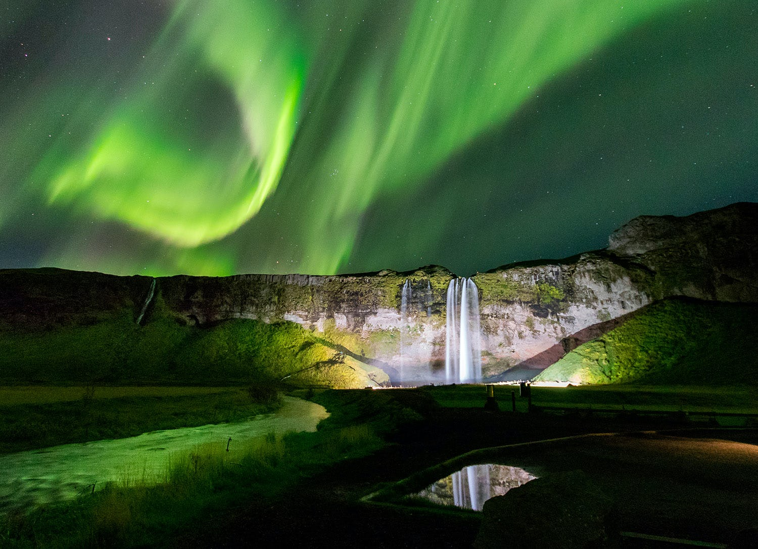 Seljalandsfoss is a spectacular waterfall, especially under the Northern Lights.