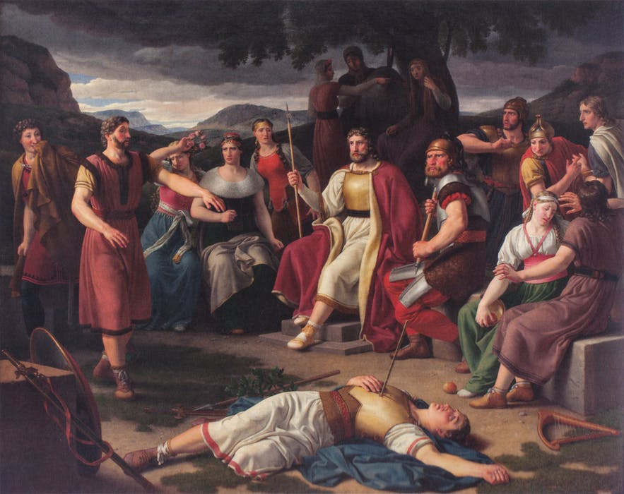 Baldr lies dead, struck in the chest by a mistletoe dart.